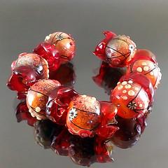 Set : Fruit of fire (Pikalda and Verada) Tags: flower set fruit fire beads colorful ebay european blossom pair earring dot line petal bee troll etsy pandora pendant glassbeads biagi focal handmadelampwork lampworksra beadssra charmbeads