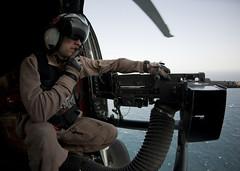 Naval Air Crewman Airman Terry Warren mans a .50 caliber machine gun. (Official U.S. Navy Imagery) Tags: arabiansea wwwfacebookcomusnavy