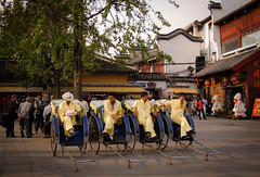 rickshaws (Xuan Che) Tags: china street plaza city travel autumn portrait history tourism 2004 yellow shop architecture square october downtown market tradition jiangnan rickshaw nanjing canonixus400 jiangsu fuzimiao
