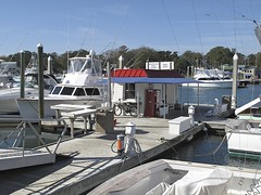 HIGH RENT DISTRICT (NC Cigany) Tags: water bike marina boats nc dock wilmington redwhiteandblue wrightsvillebeach 0656 highrentdistrict 20111204