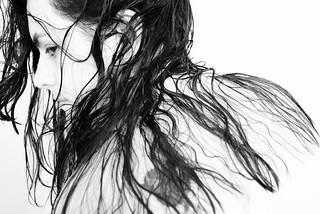 Carmen, wet hair, high contrast.