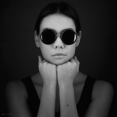 Looking cool (Tommy Hyland) Tags: portrait bw woman white black girl beautiful beauty face look sunglasses female vintage dark circle person one photo cool hands young lips human round attractive blackandwhitephoto