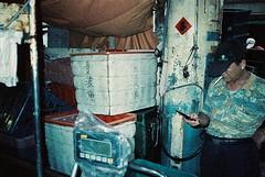 () Tags: film adox colorimplosion 100 minolta himatic af molamola oceansunfish market store vendor fishmonger man guy nanfangao