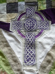 Detail Celtic Cross (onetexsun) Tags: flower art church yellow project easter purple quilt stitch blossoms textile fabric lilies quilted woven celticcross sewn lent treelimb firstunitedmethodist avalanchelily lentbannerfinished