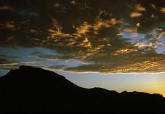 Sunset over Mt Maroon, 1990 (NettyA) Tags: park sunset sky film silhouette clouds 35mm se mt australia slide hills national scanned qld queensland barney 1990 jacksplace mtmaroon