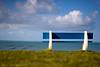 Pour se poser... (flo74.) Tags: blue sea sky mer france green bench 50mm 10 vert bleu ciel normandie f18 normandy soe banc aoi 10faves abigfave shieldofexcellence platinumheartaward photophiles artofimages