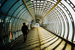 Poplar (m+b) Tags: man walking xpro crossprocessed shadows tunnel lomolca figure poplarstation autaut lomographyxprochrome100 poplarfoottun