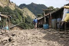 Treking through a small village on a Multi sport treking Mountain biking rafting kayaking trip in Nepal