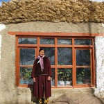 Sonam Dolma in front of his solar passive house thumbnail