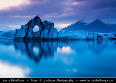 Iceland - Jkulsrln - Mirror, Mirror - Who's the fairest of them all? ( Lucie Debelkova / www.luciedebelkova.com) Tags: travel light sunset sky panorama cloud storm cold tourism ice nature water beautiful clouds sunrise wonderful dark landscape outdoors island dawn licht frozen iceland fantastic scenery europe mood view dusk lumire scenic atmosphere paisaje lagoon paisagem glacier arctic beaut stunning vista nordic paysage exploration incredible landschaft breathtaking paesaggio sland jokulsarlon jkulsrln spectacle vatnajkull evropa magiclight dramaticlight nordiccountry jokulsarlonglacierlagoon lveldisland capturenature luciedebelkova lpsky breiarmerkurjkull wwwluciedebelkovacom