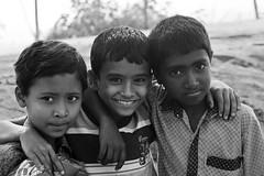 Three Friends (Tipu Kibria~~BUSY~~) Tags: boy portrait people cute boys smile childhood kids canon children eos kid village child faces innocent lifestyle dhaka villagekids bangladesh canonef70200mmf4lisusm keranigonj canoneos5dmarkii kathaltoli