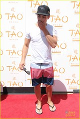 (Jonasbesties) Tags: joejonas lasvegas taobeach party seasonopeningparty hat sunglasses whiteshirt swimshorts flipflops smiling pose cute goodlooking 2012