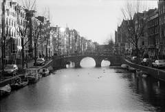 amsterdam on a sunny day (Mats Andreas Nielsen) Tags: bridge winter bw white black film public amsterdam analog private 50mm canal nikon f14 sunny places retro 400 hp5 fears ilford nikkormat ftn nikkors