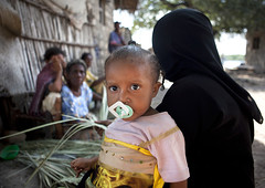 Young Woman and baby Wearing Hijab In Matondoni village - Lamu kenya (Eric Lafforgue) Tags: africa boy baby color childhood horizontal island photography kid toddler child kenya islam mother hijab culture unescoworldheritagesite afrika tradition lamu niqab babyboy swahili afrique sulking displeased eastafrica 012months qunia lamuisland lafforgue traveldestination africanethnicity kenyaafrica muslimislam  qunia islamicveil    kea 121653 exterioroutdoors   tradingroute blackethnicity a