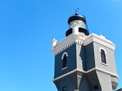 Lighthouse against blue (Omi<3) Tags: old blue sky lighthouse white black building tower puerto grey fort rico