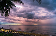 Storm passing after sunset (NettyA) Tags: sunset people tree beach water rain clouds rocks day nt australia darwin palm yachts northernterritory 2014 fanniebay darwinsailingclub sonynex6