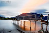 Delapidation Sunrise (Beth Wode Photography) Tags: newzealand reflection sunrise dawn pier beth jetty queenstown lakewakatipu oldjetty oldpier wode orangesunrise bethwode
