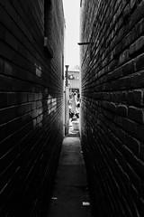 narrow gate (jeff-tidwell) Tags: street blackandwhite alley candid streetphotography streetphoto narrow
