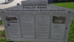 Queensboro Bridge Trolley Kiosk R.I. sign - IMGP4168 (catchesthelight) Tags: nyc newyorkcity travel red vacation sky building water sign metal skyline buildings river fun island antique manhattan decorative famous ruin transportation views kiosk 20thcentury derelict rooseveltisland trolleys smallpoxhospital thechryslerbuilding touristcenter theunitednations itsmulticolored queensborobridgekiosk