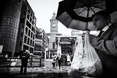 Lunch Break in the City (Fuji and I) Tags: street city blackandwhite london monochrome rain weather umbrella lunch break grain liverpoolstreet alexarnaoudov