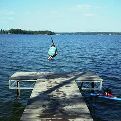 Take a leap (syndlazo) Tags: leap pier ponytail swimming lake lakelife lakemartin alabama summer run jump