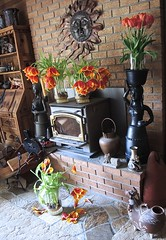 Can there ever be enough tulips? (nolleone--Nol, like Christmas) Tags: flowers sun petals spring fireplace tulips stove myhouse mexicanpottery