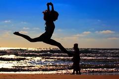 my oldest daughter exercising on the beach - Tel-Aviv (Lior. L) Tags: sea beach sport telaviv jump jumping silhouettes exercising myoldestdaughterexercisingonthebeachtelaviv
