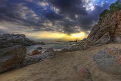The end of the day (christian&alicia) Tags: sunset sea costa seascape beach mar sand nikon rocks mediterranean sigma natura catalonia catalunya sa 1020 brava hdr cala lloret platja sorra roques catalogne boadella mediterrani d90 christianalicia