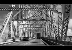 on the road again (laughlinc) Tags: road bridge blackandwhite bw car metal truck blackwhite highway traffic widescreen lr4 nikond80 thechallengefactory laughlinc lightroom4