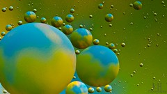 Oil Planets (97/365) (Jchales.co.uk) Tags: blue light green water yellow project day flash days worlds oil planet 365 morpheus 97 canonef100mmf28macro 430exii