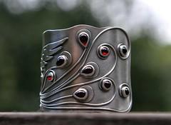 firebird (SpiralStone) Tags: phoenix metal silver jewelry jewellery bracelet metalwork firebird sterling cuff garnet recycledgold recycledsterlingsilver