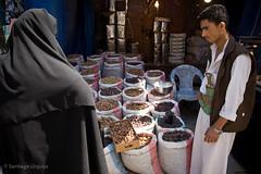 Woman in burka buying (Zalacain) Tags: woman black market hijab covered yemen sanaa buying burka khimar gettyimagesmiddleeast