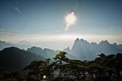 Huangshan - Directly into the Sun (Anhui - China) (Andy Brandl (PhotonMix)) Tags: china sun mountains nature misty landscape nikon asia quiet peace altitude avatar unesco lensflare serene pinetrees huangshan jamescameron anhui d7000 photonmix mountainrangeanhui avatardesigninspiration