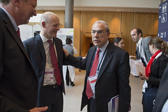 Michael Kloth talks with Angel Gurria at the Congress Center Leipzig