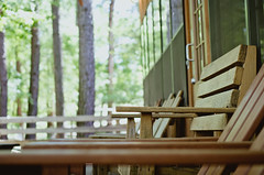 Lindale #4 (svllcn) Tags: wood trees lines architecture bench relax landscape 50mm photo nikon bokeh seat patio retreat rest