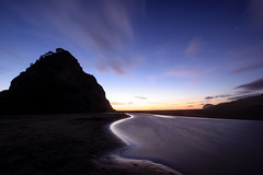 Night scene behind Lion Rock (yiraolee) Tags: new sunset sea bw beach rock night sand stream dusk 10 lion zealand stop filter nd density waitakere piha neutral