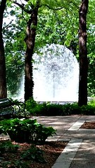 THE DANDELION FOUNTAIN THROUGH THE TREES (Visual Images1) Tags: trees water fountain 6ws loringpark dandelionfountain picmonkey