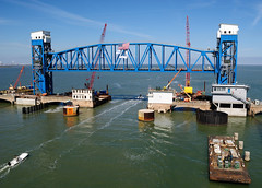 New Galveston Causeway Railroad Lift Bridge 0219121402 (Patrick Feller) Tags: railroad train lift through truss bridge galveston causeway intracoastal waterway bay county texas american flag construction crane boat barge replacement structural steel progress horizon water reflection surface wsr railway bnsf rr gulf burlington northern santa fe cianbro aggregate technologies demolition movable moving draw drawbridge pontist united states north america
