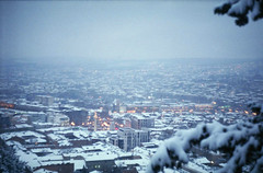 Tbilisi In Snow (Tamar Burduli) Tags: city blue winter snow cold color tree film colors yellow fog analog 35mm georgia lights evening warm cityscape fuji dusk snowing zenit tones tbilisi archtecture zenit122
