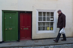 green and red (JimWicks) Tags: red green walking doors whitby hunched carying