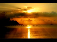 The Golden Hour (socalgal_64) Tags: ocean sea sky sun seascape nature water clouds reflections landscape boats gold islands golden glow ngc sunsets jamaica glowing caribbean rays picturesque raysoflight newvision peregrino27newvision sunrays5 howardsgallerysubmitted