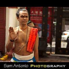 Warding off Photographers in Singapores Chinatown (Sam Antonio Photography) Tags: portrait singapore bokeh buddha candid religion streetphotography hindu hindutemple travelphotography srimariammantemple worldreligions singaporechinatown samantonio southeastasiaphotography samantoniophotographycom singaporephototour photographysingaporechinatown samantoniotravels