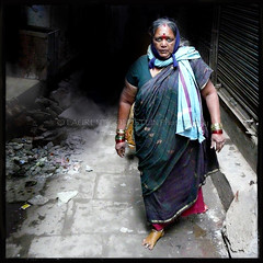 The Mistress of Spices (designldg) Tags: street people woman india yellow square colours faith spice atmosphere streetlife soul varanasi devotee turmeric dharma kashi benares benaras femininity uttarpradesh  indiasong