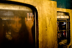 Waiting Traveler.... (Shad0w_0f_Dark) Tags: boy woman railway journey dhaka 2011 komolapur peopleinrailwayandtramenvironment
