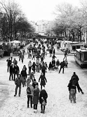 Winter in Amsterdam II (Marc Rauw.) Tags: city winter urban holland ice netherlands amsterdam geotagged canal frozen iceskating skating citylife freezing m42 prinsengracht olympuspen manualfocus jordaan gracht schaatsen m43 helios58mm geo:lat=52378081 epl1 helios58mmf20 microfourthirds μ43 geo:lon=4886158