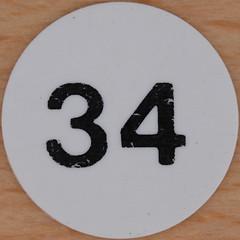 White Plastic Bingo Number 34 (Leo Reynolds) Tags: canon eos iso100 number squaredcircle lotto 60mm f80 bingo 34 loto housie housey 0sec 40d hpexif numberset numberbingo houseyhousey xsquarex housiehousie xleol30x sqset074 bingoset26