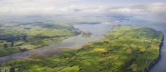 first view of the emerald isle (manyfires) Tags: ocean ireland green landscape flying inflight eire fields inlet atlanticocean emeraldisle enroute islandmagee imguessing fromglasgowtobelfast