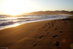 Shoeprints in the Sand (Cameron (and Liz)) Tags: ca sunset usa seagulls mist mountains beach water sand waves glare pacific santamonica footprints pacificocean santamonicamountains santamonicabeach