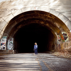 Facing Darkness (ep_jhu) Tags: road street abandoned girl standing dark scary alone arch pennsylvania entrance tunnel niña pa entrada turnpike sola decayed laurelhill túnel abandonado originallypostedon02262012174808
