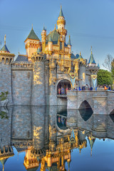Sleeping Beauty's Castle (x-ray tech) Tags: california trip bridge family blue vacation sky people west reflection tower castle water beautiful composite kids fairytale composition contrast photoshop canon fun rebel interestingness nice interesting gate colorful heraldry flickr place cross princess superb earth disneyland vibrant pastel character memories smooth dream kitlens clarity halo kingdom tourist flags calm medieval clear explore aurora definition handheld anaheim capture moat storybook magical hdr highdynamicrange herald sleepingbeauty enchanted rendering selectivefocus memorable happiest cherish photomatix traveldestination t1i